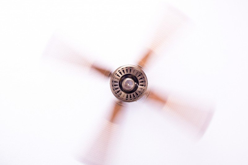 Using a ceiling fan helps cool your home in conjunction with the HVAC cooling system.